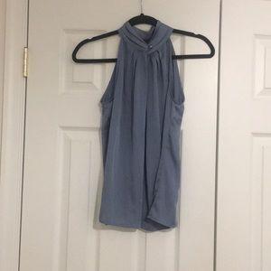 Light blue sleeveless work blouse